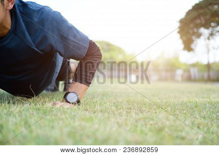 poster of Male Athlete Exercising Push Up Outside In Sunny Sunshine