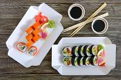 Various Kinds Of Sushi Served On Wooden Background. Sushi Menu. Japanese Food. Sushi Set. The Top Vi poster