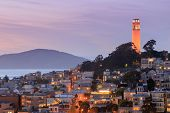 Coit Tower On Telegraph Hill With San Francisco Bay And Angel Island In The Background At Dusk. Take poster