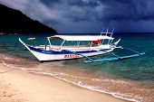 image of olongapo  - A boat in Puerto Galera in The Philippines - JPG