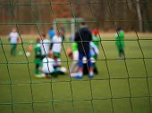 Football Gate Net. Soccer Gate Net. In Blurry Background Stand Players. Training Of Junior Team. poster