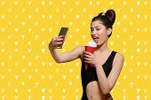 Pop Art Model Eating Ice Cream, Taking Selfie. Girl Wearing Original Fashionable Hairstyle And Brigh poster