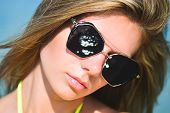 Closeup Fashion Beautiful Woman Portrait Wearing Sunglasses. Portrait Of Happy Teenage Girl In Sungl poster