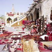 Textiles In Qatari Souq poster