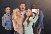 Business People Making Group Selfie While Having Fun During Break In Work In Modern Office, Copy Spa poster