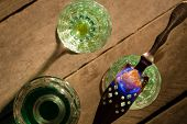 Burning Sugar On Spoon In Glass Of Absinthe. Above View. poster