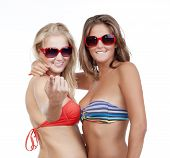 stock photo of youg  - two youg beautiful women in bikini tops showing come on gesture  - JPG