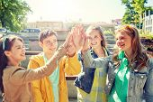 education, high school, friendship, gesture and people concept - group of happy teenage students or  poster