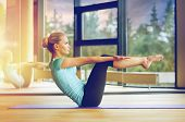 fitness, sport, training and people concept - smiling woman doing abdominal exercises on mat in gym poster
