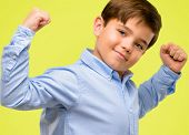 Handsome toddler child with green eyes showing biceps expressing strength and gym concept, healthy l poster