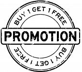 Grunge Black Promotion Buy 1 Free 1 Round Rubber Seal Stamp On White Background poster