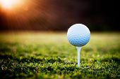 stock photo of golf  - Close up of golf ball on tee - JPG