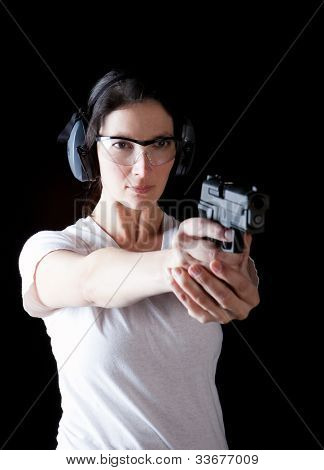 Woman aiming a gun with