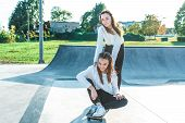Two Teenage Girls Teenagers Ride Skateboard, Happy Have Fun Playing Laughing, Summer Sports Ground,  poster