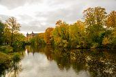 Denmark, Copenhagen, Europe: Beautiful Autumn Landscape, Trees Reflected In The Water In Copenhagen  poster