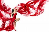 picture of bend over  - Beautiful woman dancing in red dress flying on a wind flow over white background - JPG
