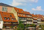 stock photo of regnitz  - Situated on seven hills like ancient Rome Bamberg features a splendidly preserved old town encircled by the branches of the river Regnitz - JPG