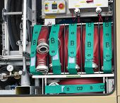 stock photo of firehose  - several fire hoses on a fire truck - JPG