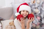 Playful Mood. Creating Festive Atmosphere. Child Decorating Christmas Tree With Red Ball. Girl Kid D poster