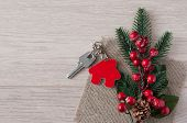Beautiful Christmas background: decorative house and key to the lock. Concept of finance and housing poster