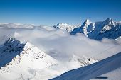 amazing snow covered peaks in the Swiss alps Jungfrau region from Schilthorn poster