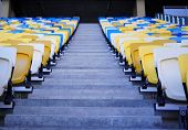 Football Stadium Tribune. Plastic Seats Of The Open Stadium, Close-up. Rows Of Seats For Spectators  poster