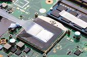 Replacing Thermal Paste On A Laptop. Applying Thermal Paste To The Laptop Processor. poster