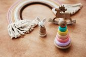 Eco Friendly Plastic Free Toys For Toddler. Stylish Wooden Toys For Child On Wooden Table. Modern Co poster