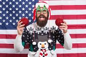 Decorate Christmas With Patriotism. Patriotic Hipster Hold Christmas Tree Balls. Bearded American Ma poster