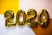 Celebrating The New Year 2020, Golden Foil Balloons 2020 On Colorful Backgrounds. Foil Balls. poster