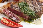 Piece Of Medium Rare Steak With Spicy Herb Sauce poster