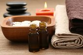 picture of essential oil  - essential oils flowers and towels  - JPG