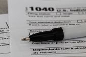 Tax Form Business Financial Concept: Macro View Of Individual Return Tax Form And Ballpoint Pen poster