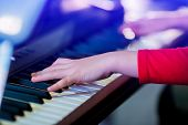 Closeup Kids Hand Playing Piano On Stage With Lighting. Favorite Classical Music. poster