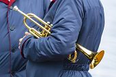 Two Men Are Standing In Blue Cloaks. One Of Them Has Wind Musical Instrument -  Trumpet Under Arm. S poster