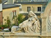 stock photo of partially clothed  - Marble sculpture of a partially nude woman reclining - JPG
