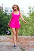 foto of slut  - Young sexy Blonde in Pink Latex dress - JPG