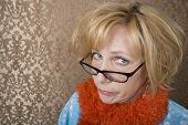 foto of tawdry  - Crazy woman with glasses suspiciouly eyeing the camera - JPG