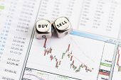 Dices Cubes With The Words Sell Buy On Downtrend Financial Diagram. Selective Focus