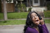 pic of horrifying  - Horrified young African American woman in a purple top - JPG