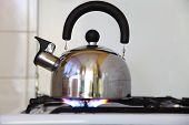 Tea Kettle On A Flaming Gas Stove.