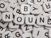 stock photo of nouns  - Noun part of speech on white letter tiles - JPG
