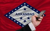 Cell Phone In Front  Flag Of American State Of Arkansas