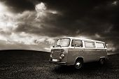 stock photo of hippies  - Vintage hippie van in the grass field - JPG
