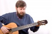 foto of acoustic guitar  - The man adjusting an acoustic guitar close - JPG