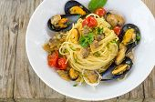 picture of clam  - dish of italian pasta stuffed with mussels and clams - JPG