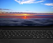 stock photo of rutin  - black laptop keyboard and beautiful sunset display - JPG