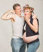 pic of hillbilly  - Amazed pregnant hillbilly woman and man flexing biceps - JPG