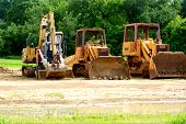 stock photo of wheel loader  - Front  end loaders that are parked in secure area of a construction site - JPG