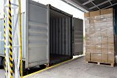 pic of lift truck  - Forklift with carton boxes loading the truck - JPG